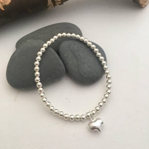 silver beaded bracelet with puffy heart