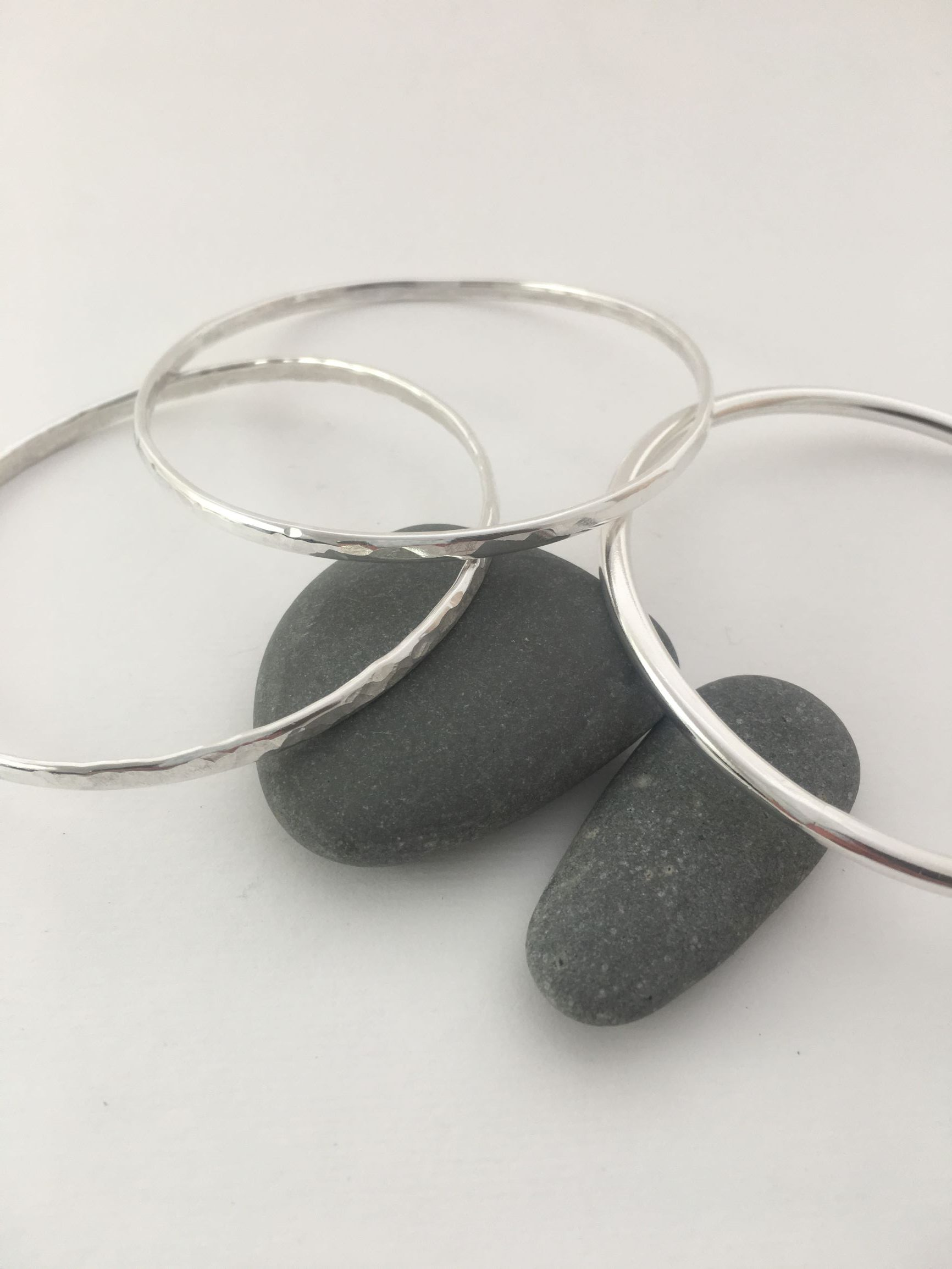 simple silver bangles by Silver and Stone